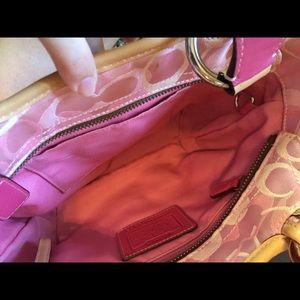 Coach Bags - COACH light pink signature bag with vachetta trim